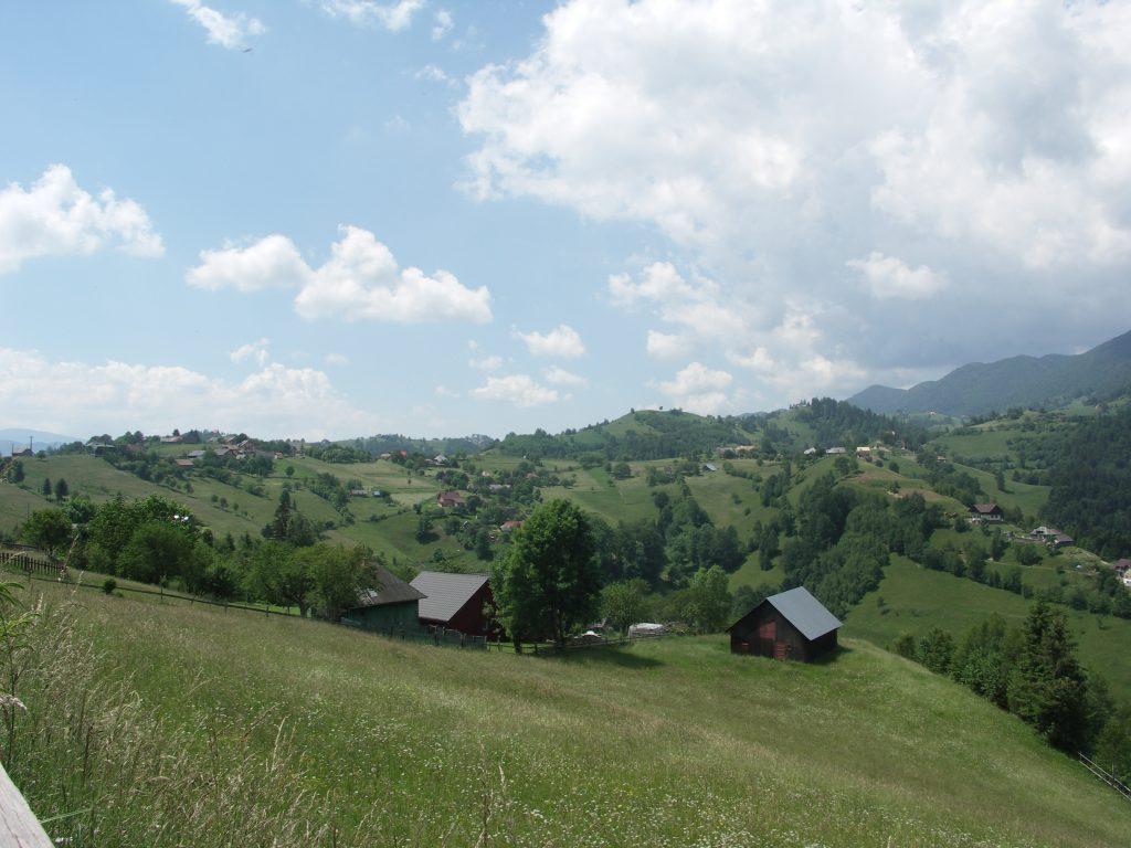Eco tourism. Blue sky, green hills & mountain village view