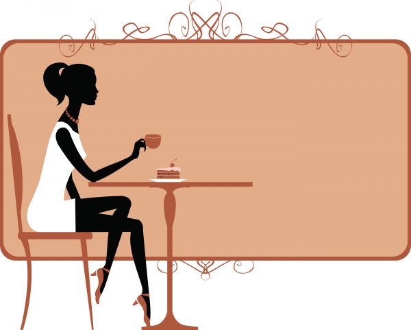 Silhouette of a girl drinking coffee in a coffee shop